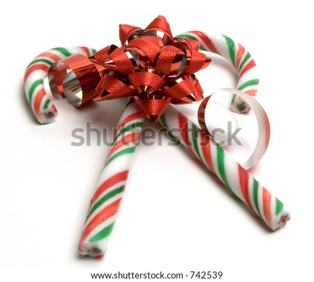 Two christmas candy canes and a bow