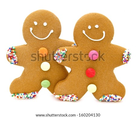 Two Christmas gingerbread men over a white background - stock photo