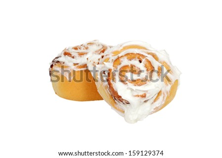 two cinnamon buns with icing - stock photo
