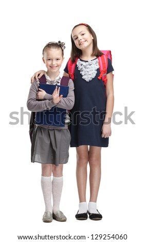 Two classmates are happy to start new year of study, isolated, white background - stock photo