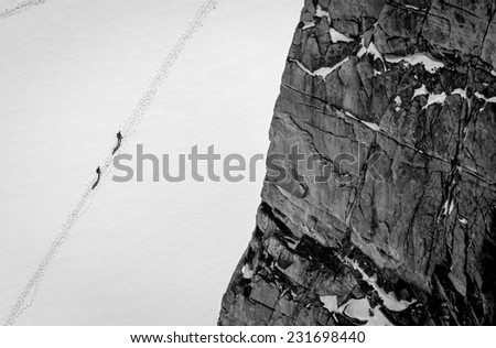 Two climbers in snow, ariel view - stock photo