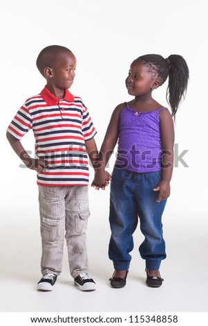 Two close friends are holding hands. - stock photo
