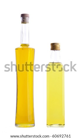 two closed bottles of olive oil isolated over white