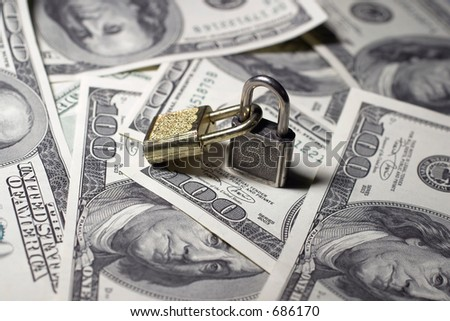 Two closed locks on money - stock photo