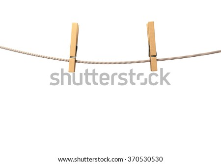 two clothespins on rope