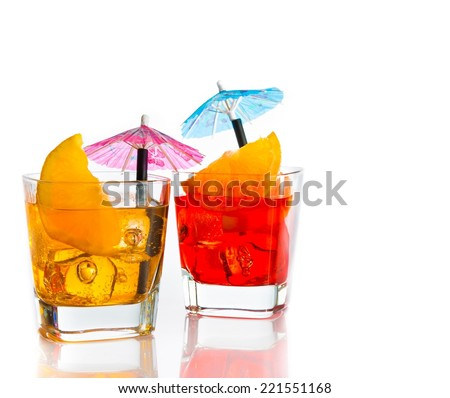 two cocktail with orange slice and umbrella on top isolated on white background with space for text - stock photo