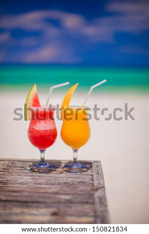 Two cocktails: fresh watermelon and mango on the background of stunning turquoise sea