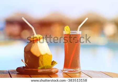 Two cocktails on beach resort - stock photo