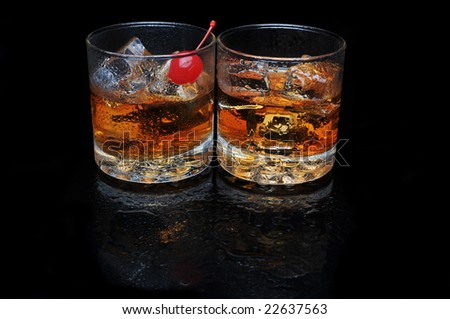 Two Cocktails on black reflective surface with reflections