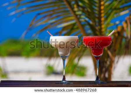 Two cocktails on luxury tropical sand beach