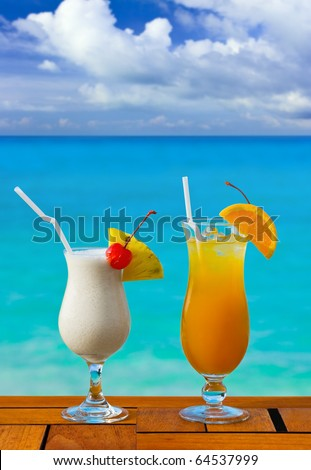 Two cocktails on table at beach cafe - vacation background - stock photo