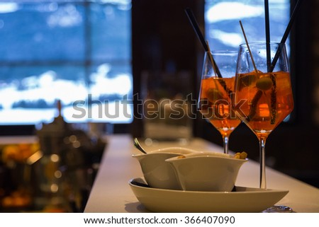 Two cocktails on the bar counter in the mountain bar in Alps - stock photo