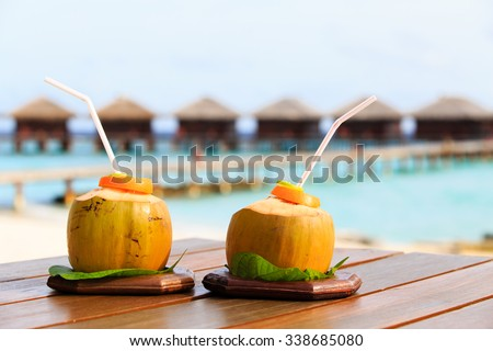 two coconut drinks on luxury tropical resort in Maldives - stock photo