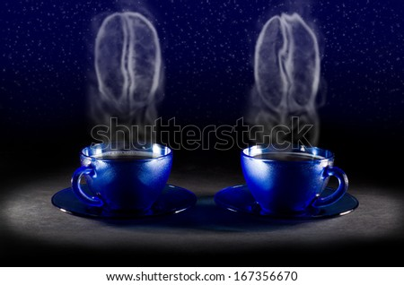 Two coffee cups with steam in the form of coffee beans - stock photo