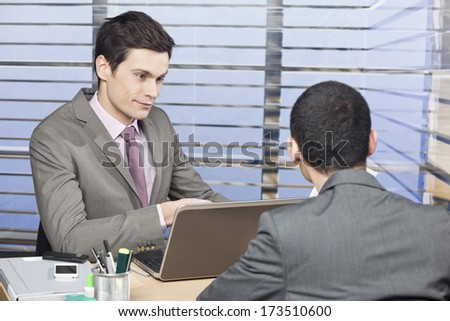 Two colleagues discussing in the office