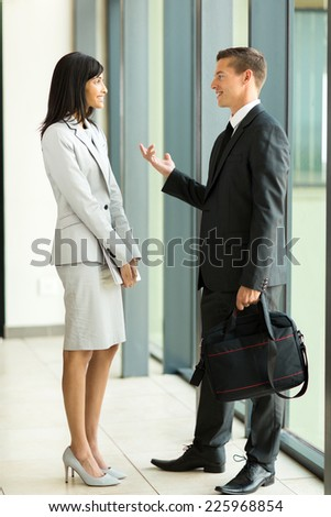 two colleagues having conversation in office - stock photo