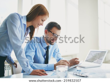 Two colleagues using touchpad