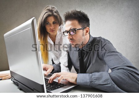 two colleagues working at the computer - stock photo