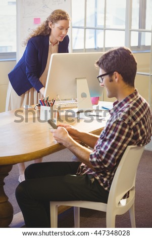 Two colleagues working in the same office at workplace