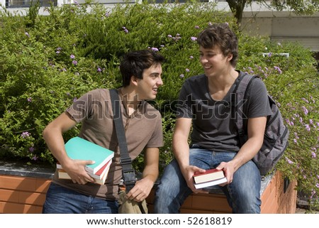 Two college or university students speaking and smiling