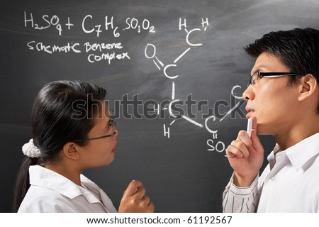 Two college student discussing about chemistry problem