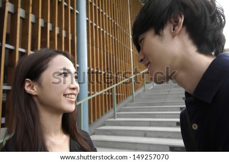 two college students on campus - stock photo