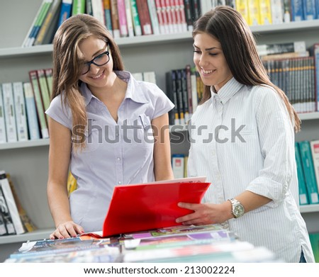 Two college students on university campus - stock photo