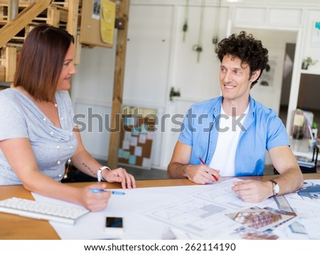 Two collegues having discussion in office - stock photo