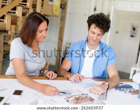 Two collegues having discussion in office