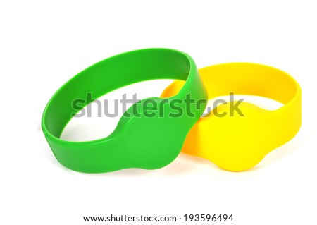 two color rfid bracelet on a white background - stock photo