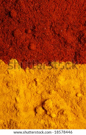 two color spices - pile of ground turmeric and paprika, background - stock photo