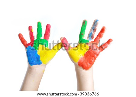 Two colored child's hands - stock photo