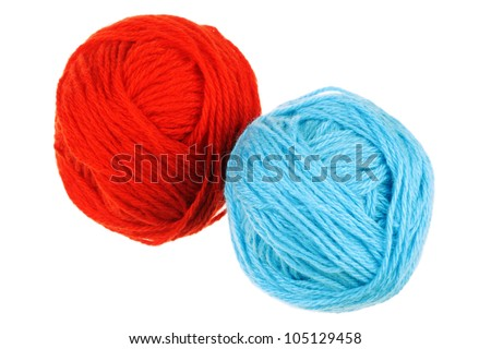 Two colored woolen balls on a white background