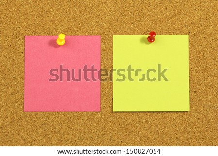 two colorful blank cards on cork board