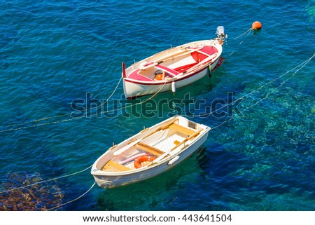 Two colorful boats on the sea. Transparent blue water in summer. Cinque Terre, Italy. - stock photo