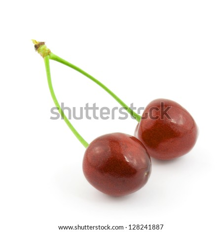 two colorful cherries isolated on white