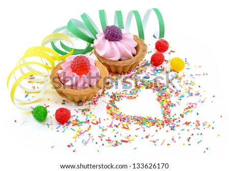 Two colorful creamy cakes with jelly berries isolated