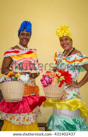 Two colorful Cuban ladies in traditional costumes