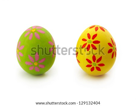 Two colorful Easter eggs on white background - stock photo