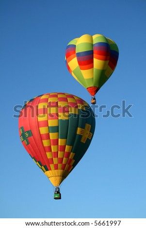 Two colorful hot air balloons during an early morning ascend - stock photo