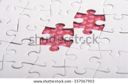 Two colorful puzzle, as man and woman fit together like a puzzle.