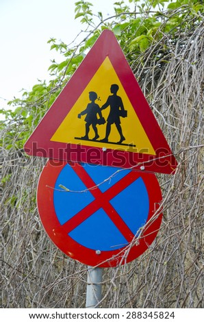 two colorful road school signs on street, Greece - stock photo