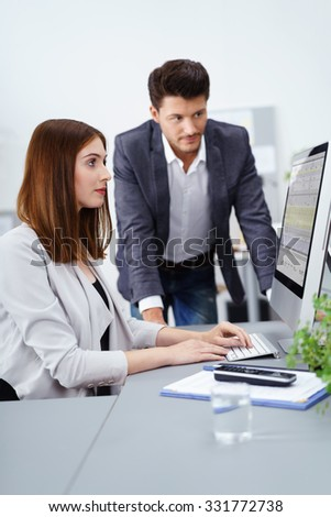 two competent businesspeople working together at the office - stock photo
