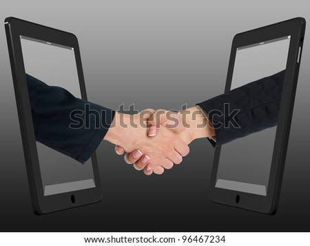 Two Computer Device and Hands in handshaking, Incernet Working Concept, Wireless Communication