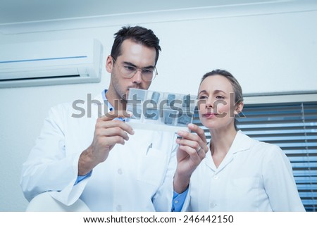 Two concentrated dentists looking at x-ray - stock photo