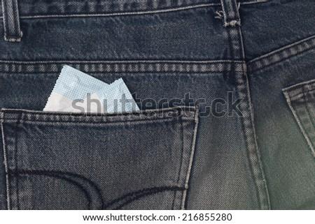 Two condoms in jean. - stock photo