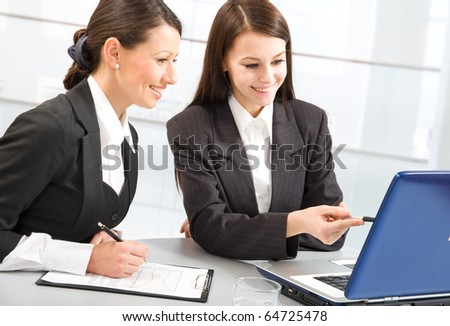 Two confident business ladies