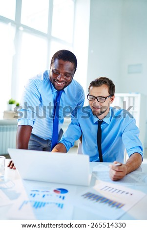 Two confident employees networking at meeting - stock photo