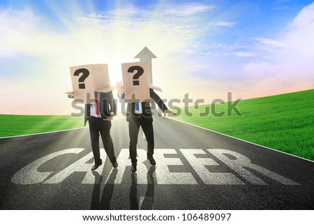 Two confused businessman finding the career path with heads covered by cardboard