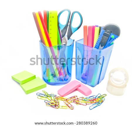 two containers with office supplies close-up on white background - stock photo